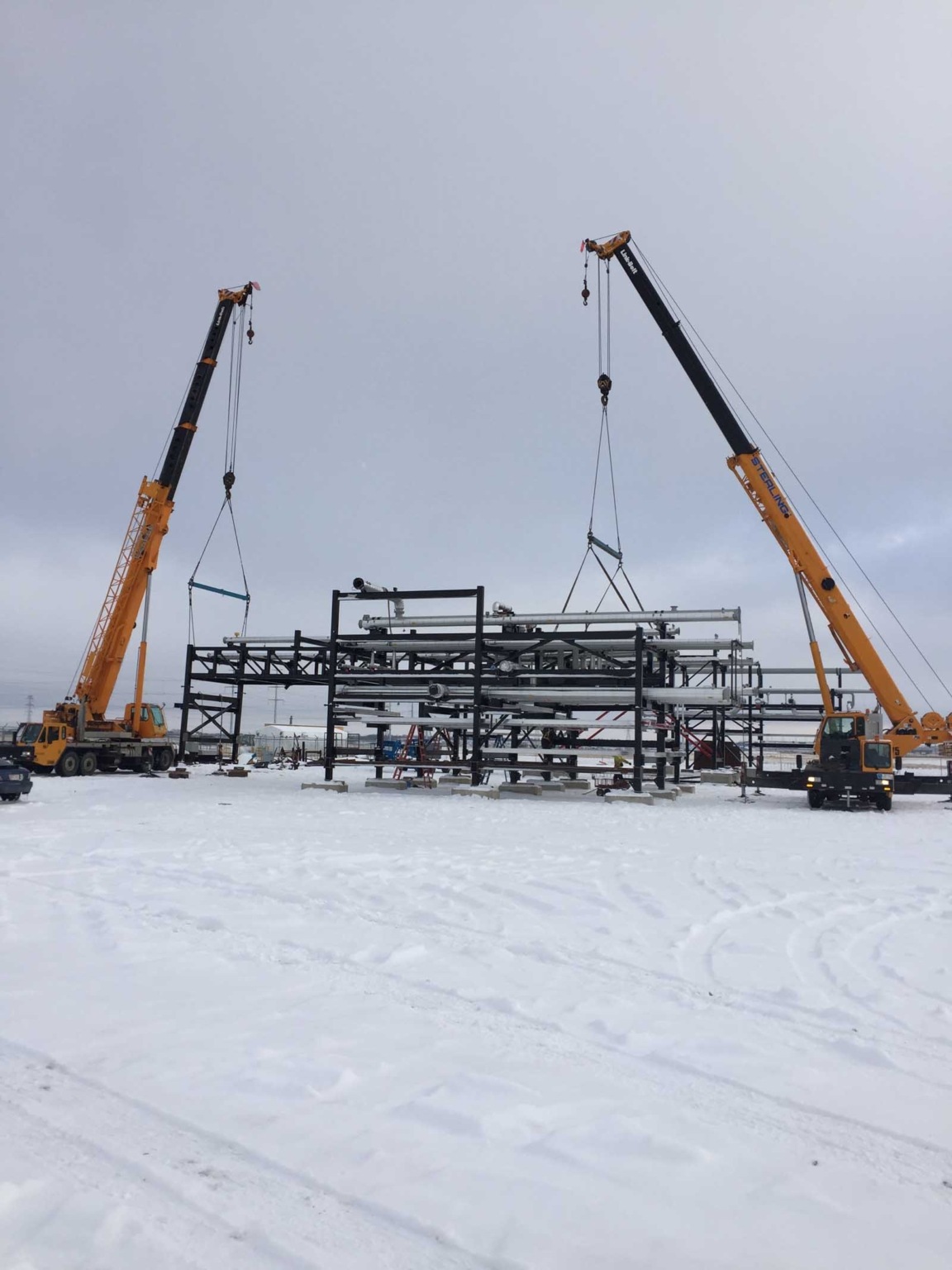 Cranes in snow loading pipes
