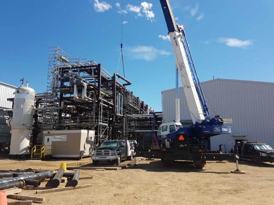 Crane loading pipe at location